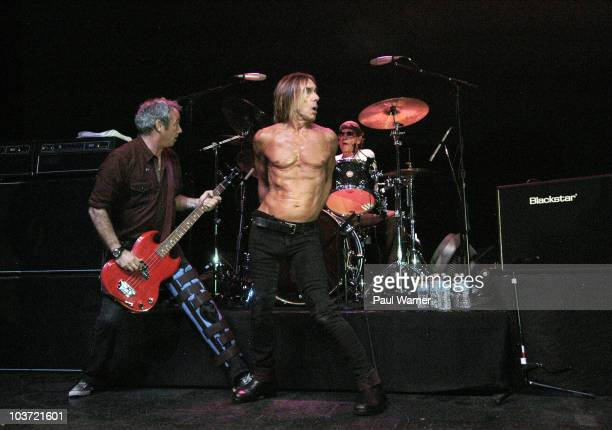 Bassist Mike Watt vocalist Iggy Pop and drummer Toby Dammit perform as Iggy and the Stooges at Riviera Theatre on August 29 2010 in Chicago Illinois