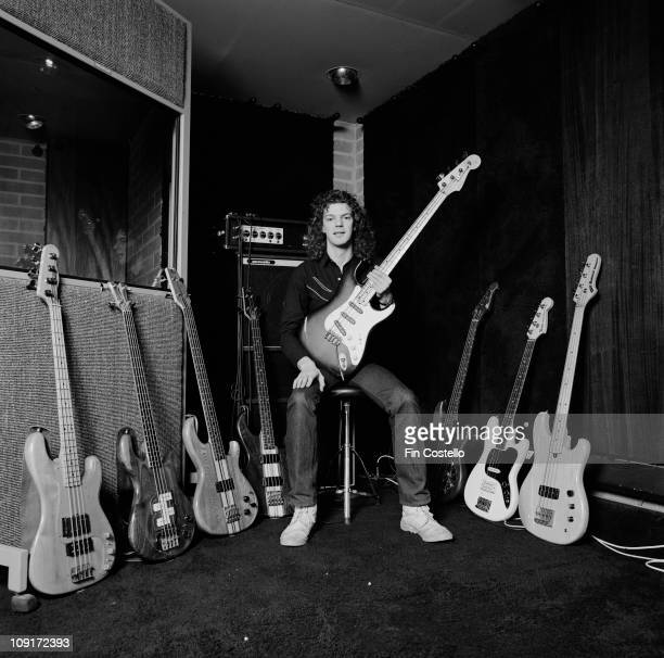 bassist Neil Murray from Whitesnake posed with his bass guitars at Britannia Row recording studios in London in March 1981