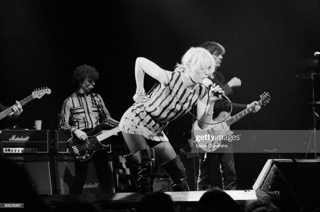 Bassist Nigel Harrison, singer Debbie Harry and guitarist Chris Stein of American band Blondie perform on stage at the Free Trade Hall in Manchester on December 28, 1979.