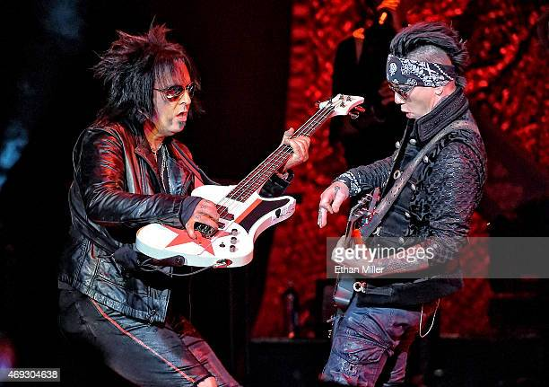 Bassist Nikki Sixx and guitarist Dj Ashba of SixxAM perform at The Joint inside the Hard Rock Hotel Casino on April 10 2015 in Las Vegas Nevada
