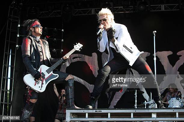 Bassist Nikki Sixx and singer James Michael of Sixx AM perform during 2016 Carolina Rebellion at Charlotte Motor Speedway on May 6 2016 in Concord...