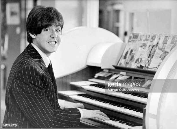 Bassist Paul McCartney of the rock and roll band 'The Beatles' plays an organ in circa 1965
