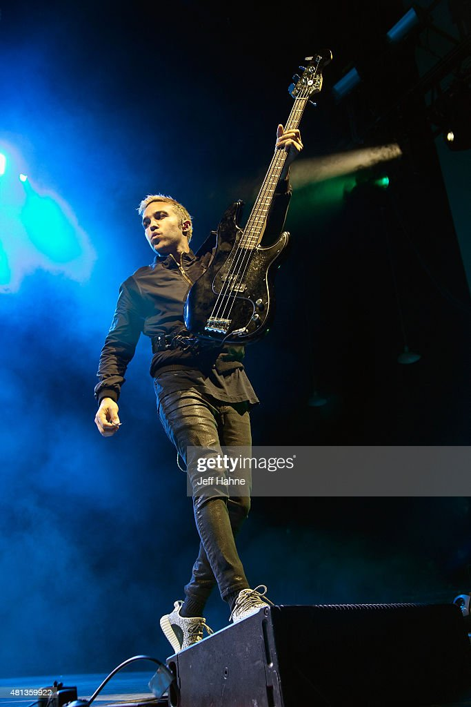Bassist Pete Wentz of Fall Out Boy performs at PNC Music Pavilion on July 19, 2015 in Charlotte, North Carolina.