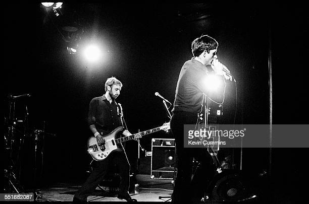 Bassist Peter Hook and singer Ian Curtis performing with rock group Joy Division at Leigh Open Air Festival 27th August 1979 The event was held on...