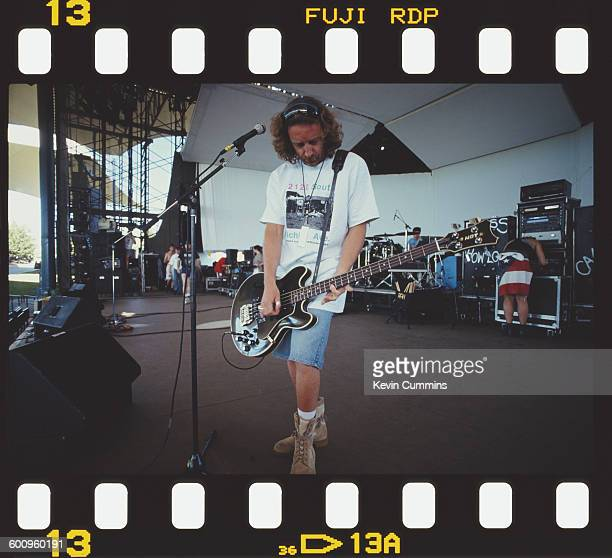 Bassist Peter Hook of English rock group New Order soundchecking on the stage of the Kingswood Music Theatre at the Canada's Wonderland theme park in...