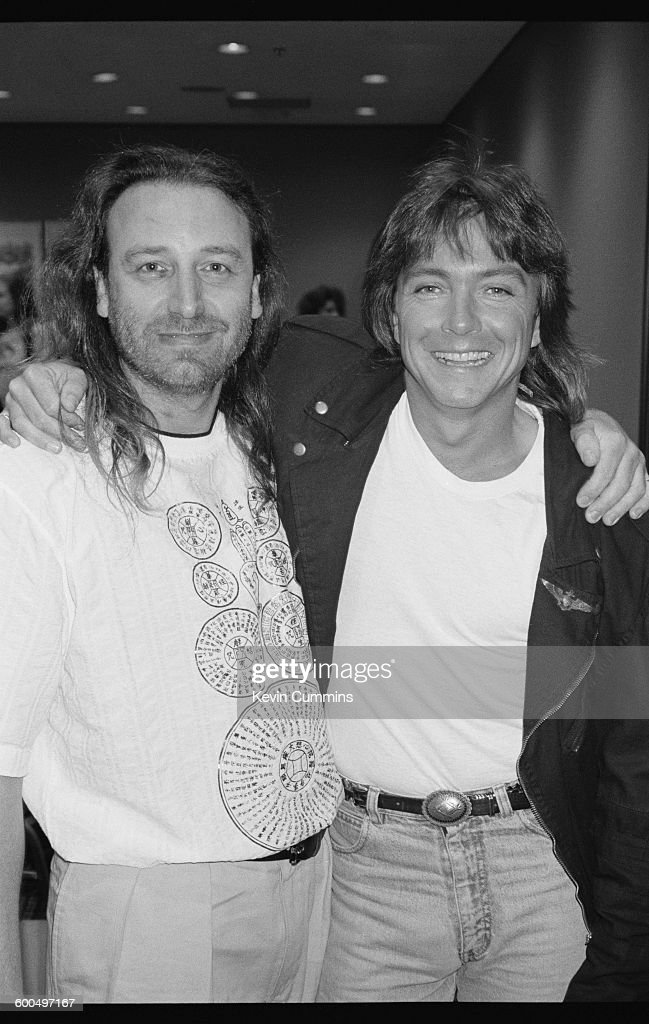 Bassist Peter Hook (left) of English rock group New Order, with American pop singer and actor David Cassidy, New York City, July 1990.