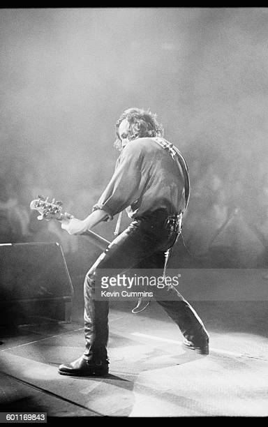Bassist Peter Hook performing with English rock group New Order during the band's North American tour JulyAugust 1993