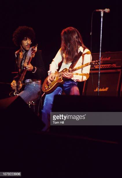 Bassist Phil Lynott and guitarist Gary Moore of Thin Lizzy perform at the Omni Coliseum on February 21 1977 in Atlanta Georgia