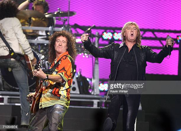 Bassist Rick Savage, drummer Rick Allen, and singer Joe Elliott of Def Leppard performs with Brian May of Queen during the VH1 Rock Honors at the...