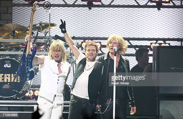 Bassist Rick Savage, drummer Rick Allen, and singer Joe Elliott of Def Leppard performs during the VH1 Rock Honors at the Mandalay Bay Events Center...