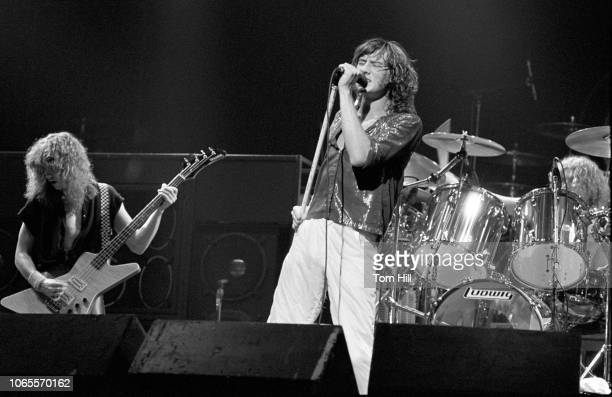 Rick Savage Joe Elliott and Rick Allen of Def Leppard perform at The Fox Theater on September 4 1981 in Atlanta Georgia