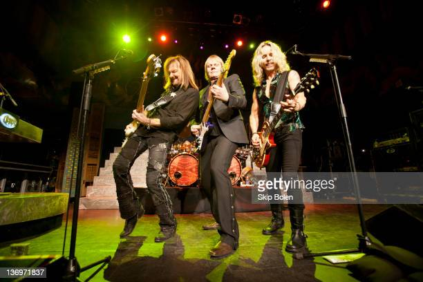 Bassist Ricky Phillips guitarist/vocalist James Young and guitarist/vocalist Tommy Shaw of Styx performs at the House of Blues on January 13 2012 in...