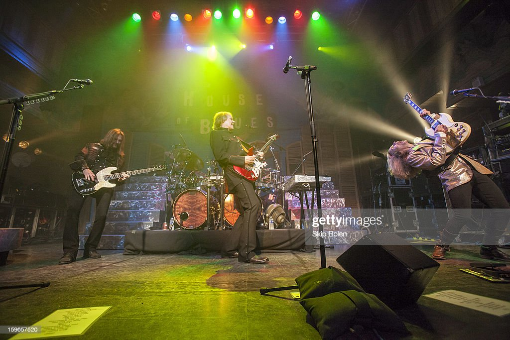 Bassist Ricky Phillips with guitarists James Young and Tommy Shaw of the band Styx performs at the House of Blues on January 17, 2013 in New Orleans, Louisiana.