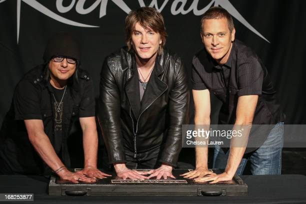 Bassist Robby Takac vocalist / guitarist John Rzeznik and drummer Mike Malinin of Goo Goo Dolls are inducted into Guitar Center's historic RockWalk...