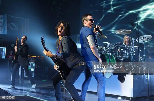 Bassist Robert DeLeo guitartist Dean DeLeo singer Scott Weiland and drummer Eric Kretz of Stone Temple Pilots perform at the Riviera Theatre on March...