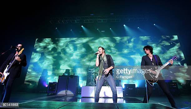 Bassist Robert DeLeo Vocalist Scott Weiland and Guitarist Dean DeLeo of Stone Temple Pilots perform live at The Fox Theatre on October 20 2009 in...