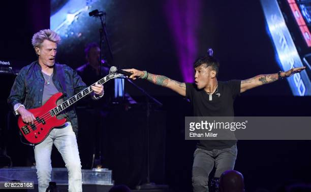 Bassist Ross Valory and singer Arnel Pineda of Journey perform during the first night of the band's second nineshow residency at The Joint inside the...