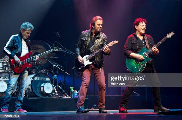 Bassist Ross Valory keyboardist Jonathan Cain and founder and guitarist Neal Schon of the band Journey are seen at Prudential Center on June 15 2018...
