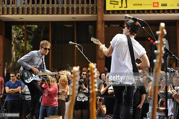Bassist Steven Jeffery and singer/guitarist Keith Jeffery of Atlas Genius perform live at Warner Bros Records Boutique Store on August 9 2013 in...