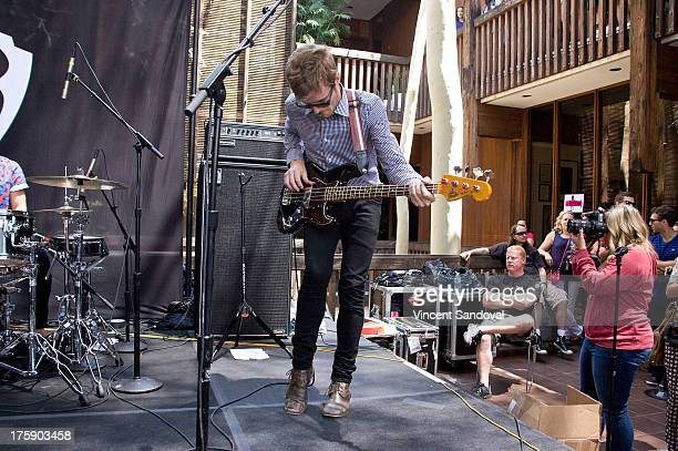 Bassist Steven Jeffery of Atlas Genius performs at the WBR Summer Sessions at Warner Bros Records boutique store on August 9 2013 in Burbank...