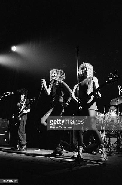 Bassist Tessa Pollitt singer Ari Up and guitarist Viv Albertine of punk band The Slits perform on stage at the Apollo in Manchester England on...