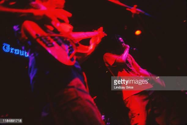 Bassist Tim Commerford drummer Brad Wilk vocalist Zack de la Rocha and guitarist Tom Morello perform in Rage Against the Machine at The Troubadour on...