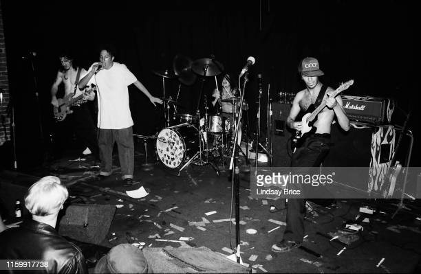 Bassist Tim Commerford vocalist Zack de la Rocha drummer Brad Wilk and guitarist Tom Morello perform in Rage Against the Machine at Club Lingerie in...