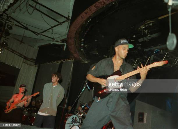 Bassist Tim Commerford vocalist Zack de la Rocha drummer Brad Wilk and guitarist Tom Morello perform in Rage Against the Machine at the Hollywood...