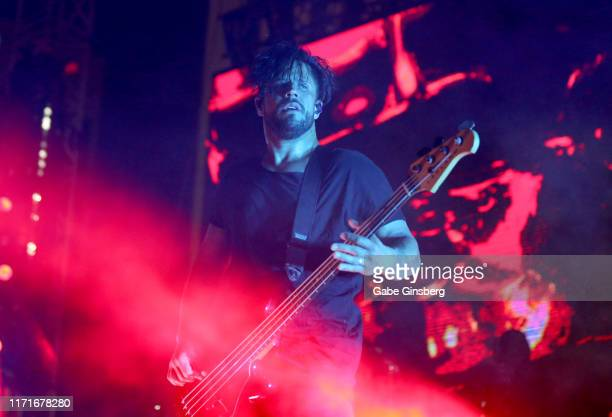 Bassist Tobin Esperance of Papa Roach performs during the final night of the Who Do You Trust tour at the Downtown Las Vegas Events Center on...