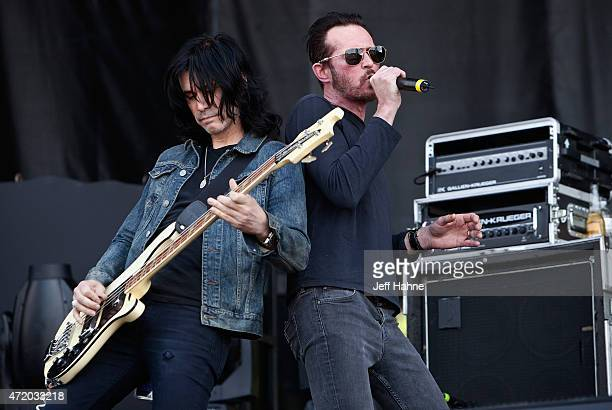 Bassist Tommy Black and singer Scott Weiland of Scott Weiland and the Wildabouts perform during day 1 of the Carolina Rebellion at Charlotte Motor...