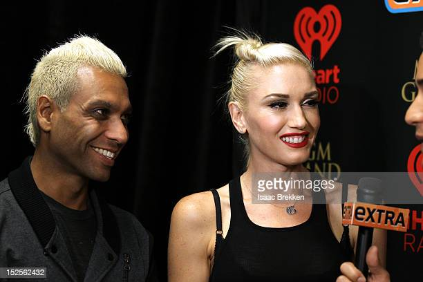 Bassist Tony Kanal and singer Gwen Stefanil of No Doubt appear backstage during the 2012 iHeartRadio Music Festival at the MGM Grand Garden Arena on...
