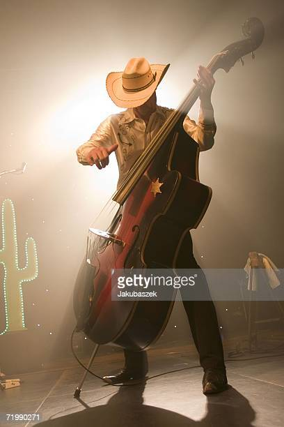 """Bassist Uwe Frenzel of the German country band """"Texas Lightning"""" performs live during a concert at the Columbiahalle September 25, 2006 in Berlin,..."""