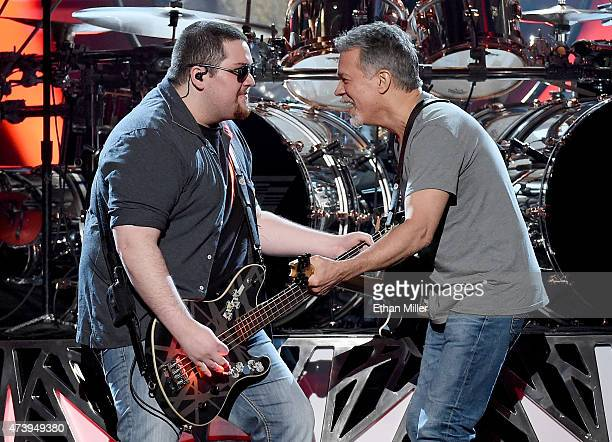 Bassist Wolfgang Van Halen and guitarist Eddie Van Halen of Van Halen perform during the 2015 Billboard Music Awards at MGM Grand Garden Arena on May...