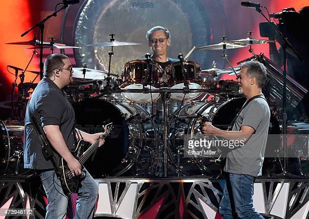 Bassist Wolfgang Van Halen drummer Alex Van Halen and guitarist Eddie Van Halen of Van Halen perform during the 2015 Billboard Music Awards at MGM...