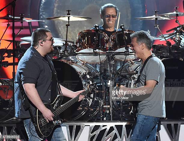 Bassist Wolfgang Van Halen, drummer Alex Van Halen and guitarist Eddie Van Halen of Van Halen perform during the 2015 Billboard Music Awards at MGM...