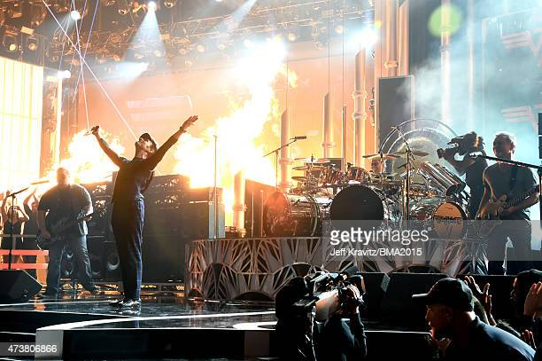 Bassist Wolfgang Van Halen singer David Lee Roth drummer Alex Van Halen and drummer Eddie Van Halen perform onstage during the 2015 Billboard Music...