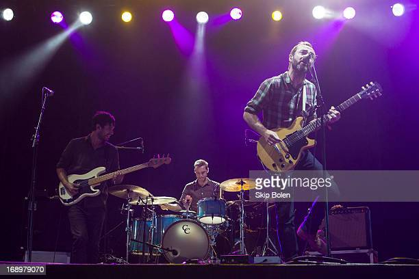 Bassist Yuuki Matthews drummer Joe Plummer and vocalist/guitarist James Mercer of The Shins performs during the 2013 Hangout Music Festival on May 17...