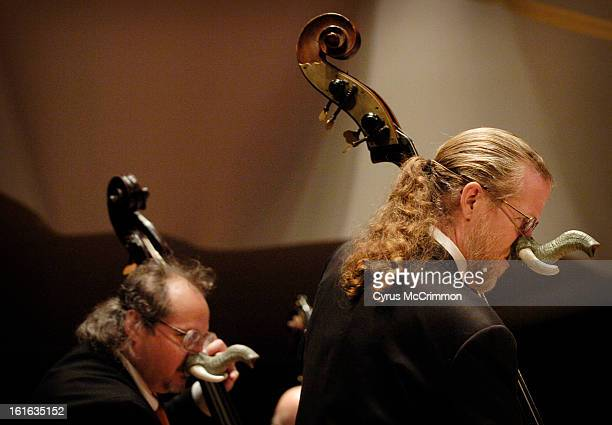 Bassists Ron Bland and Mike Fitzmaurice donned elephant noses as they demonstrated the deep sounds of their basses during the Junior Symphony Guild's...