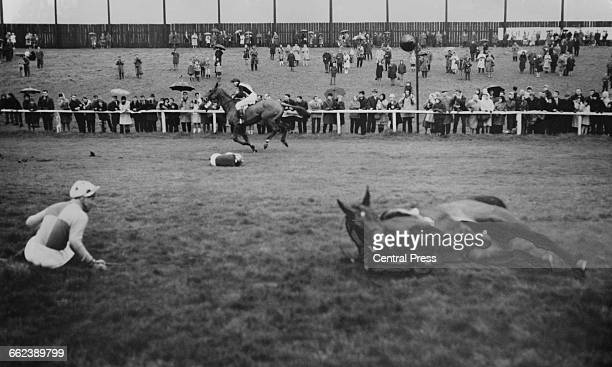 Bassnet and his jockey, David Nicholson , after falling at the first fence during the Grand National at Aintree Racecourse, Liverpool, 8th April...