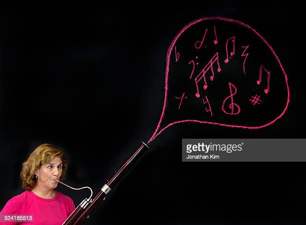 bassoonist performs music in a bubble. - bassoon stock pictures, royalty-free photos & images