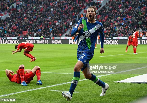 Bast Dost of VfL Wolfsburg celebrates as he scores the winning goal during the Bundesliga match between Bayer 04 Leverkusen and VfL Wolfsburg at...