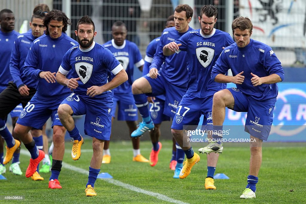 Bastia L1 football team players warm up before the French L1 football match Bastia (SCB) against Lyon (OL) on November 22, 2014 in the Armand Cesari stadium in Bastia, French Mediterranean island of Corsica.