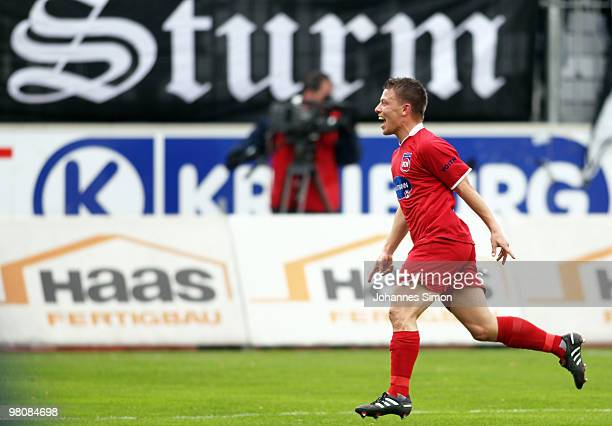 Bastian Heidenfelder of Heidenheim celebrates after scoring 2-0 during the third division match between Wacker Burghausen and 1. FC Heidenheim at the...