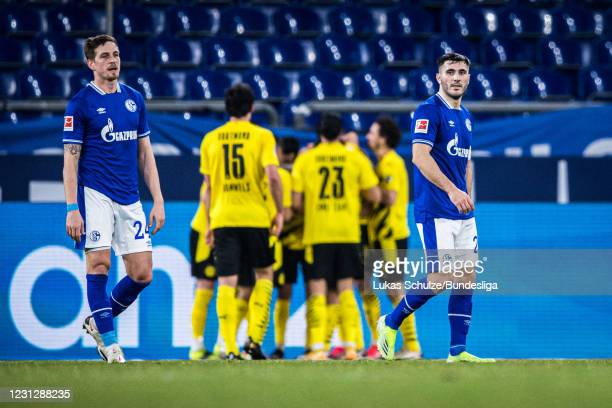 Bastian Oczipka and Sead Kolasinac of Schalke look disappointed after getting the second goal during the Bundesliga match between FC Schalke 04 and...
