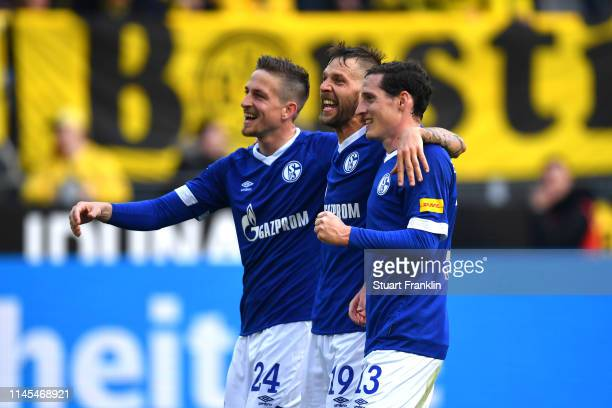 Bastian Oczipka Guido Burgstaller and Sebastian Rudy of FC Schalke 04 celebrate after the Bundesliga match between Borussia Dortmund and FC Schalke...