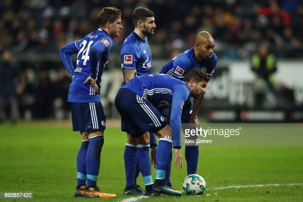Bastian Oczipka Guido Burgstaller Daniel Caligiuri and Naldo of Schalke prepare a free kick during the Bundesliga match between Eintracht Frankfurt...