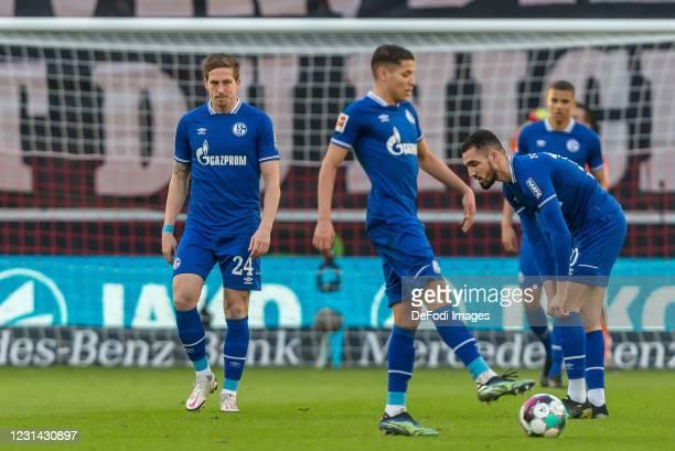 Bastian Oczipka of FC Schalke 04, Amine Harit of FC Schalke 04 and Nabil Bentaleb of FC Schalke 04 looks dejected during the Bundesliga match between...