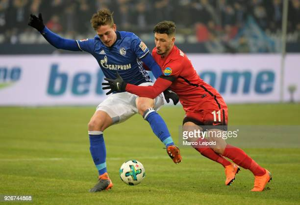 Bastian Oczipka of FC Schalke 04 and Mathew Leckie of Hertha BSC during the first Bundesliga match between Schalke 04 against Hertha BSC at the...