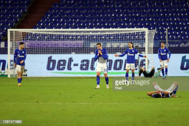 Bastian Oczipka of FC Schalke 04 and teammates react after conceding their second goal during the Bundesliga match between FC Schalke 04 and 1. FC...