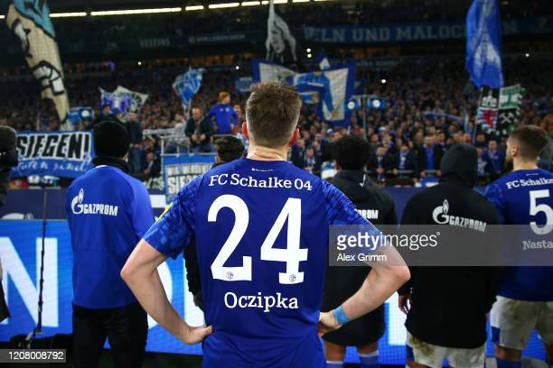 Bastian Oczipka of FC Schalke 04 apologise to the fans after the Bundesliga match between FC Schalke 04 and RB Leipzig at Veltins-Arena on February...